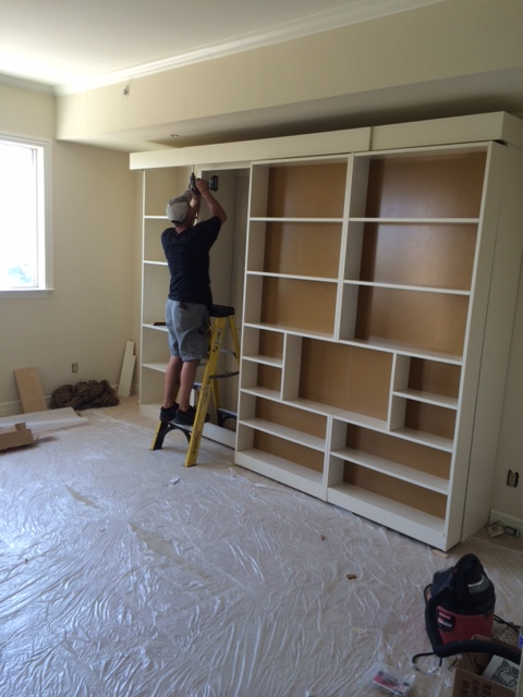 Finishing touches on the Jefferson Library Bed