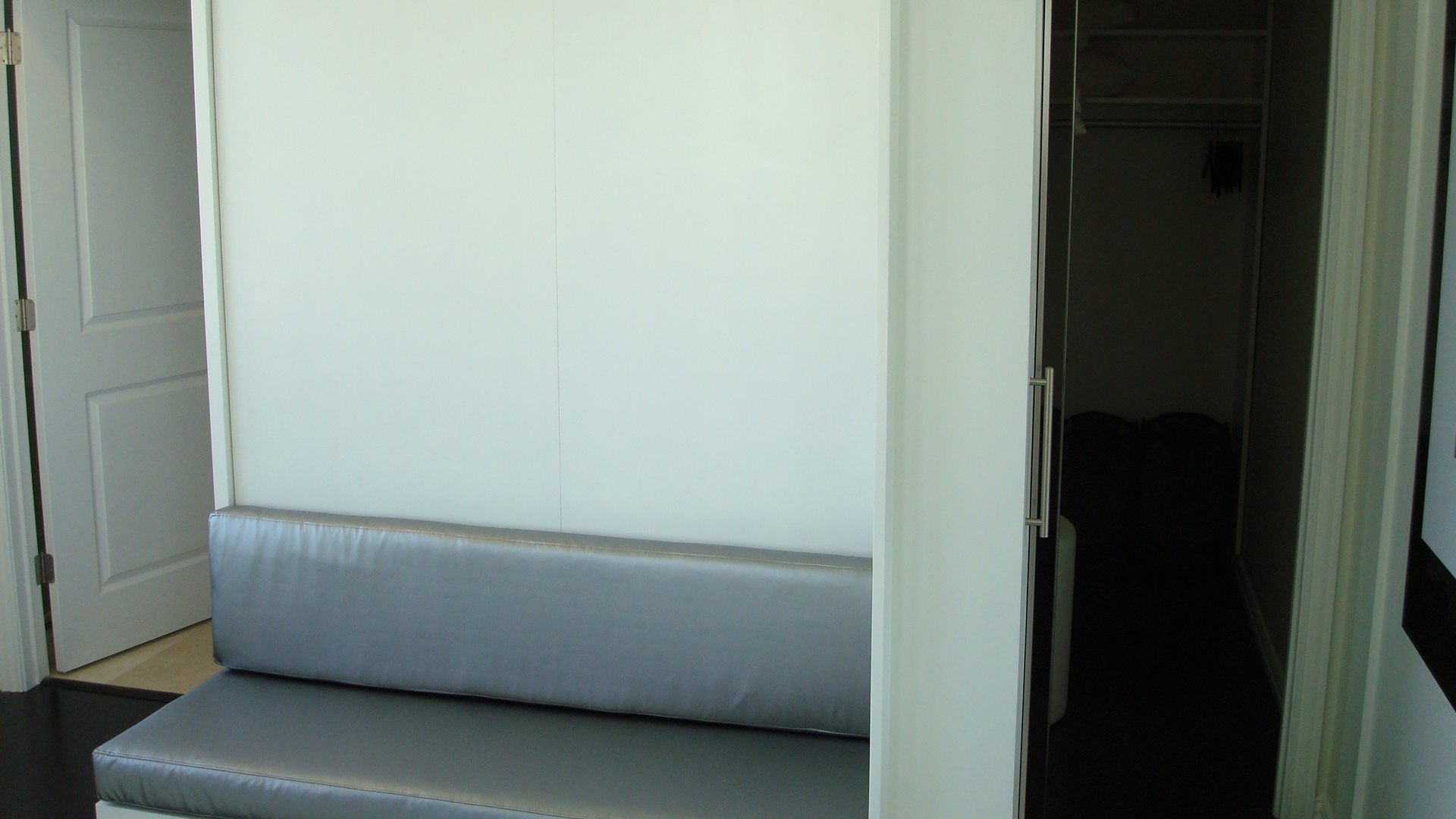 Bed Is Shown Closed With A Custom Sofa. To The Right Is The Hidden Closet