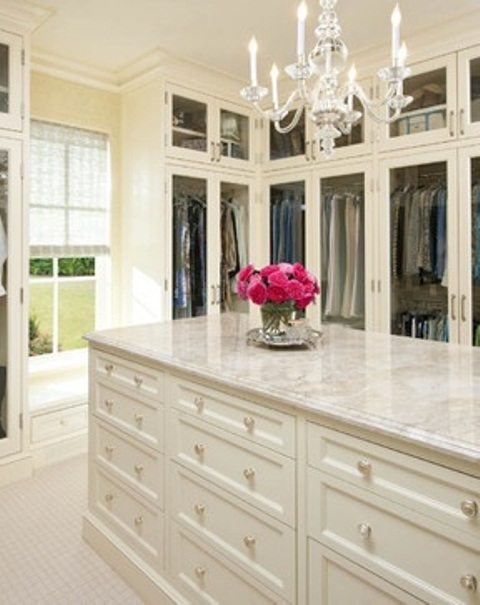 white walk-in closet with chandelier