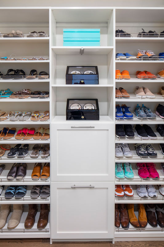 Walkin Closet with shoe shelves and Laundry Hampers