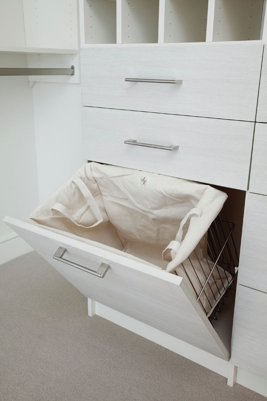Laundry hampers in closets reduce clutter in walk-in closets