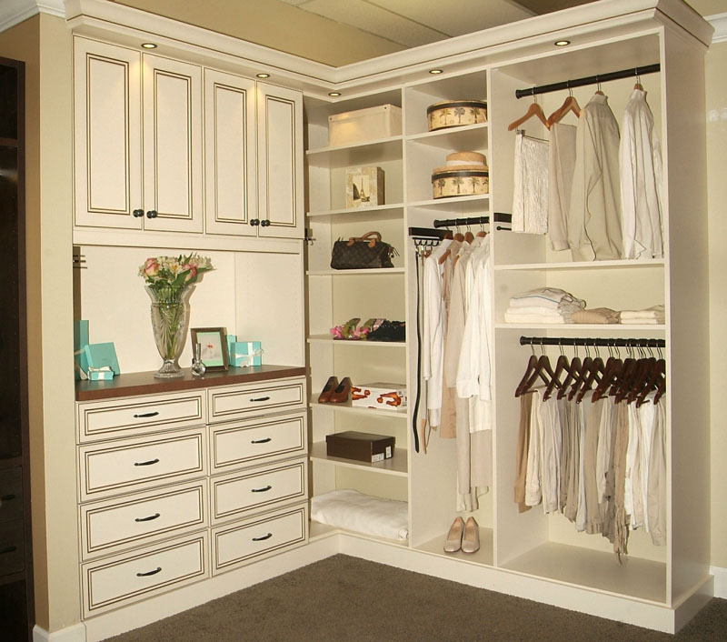 Walk-in closet in glazed antique white fronts and drawer stacks