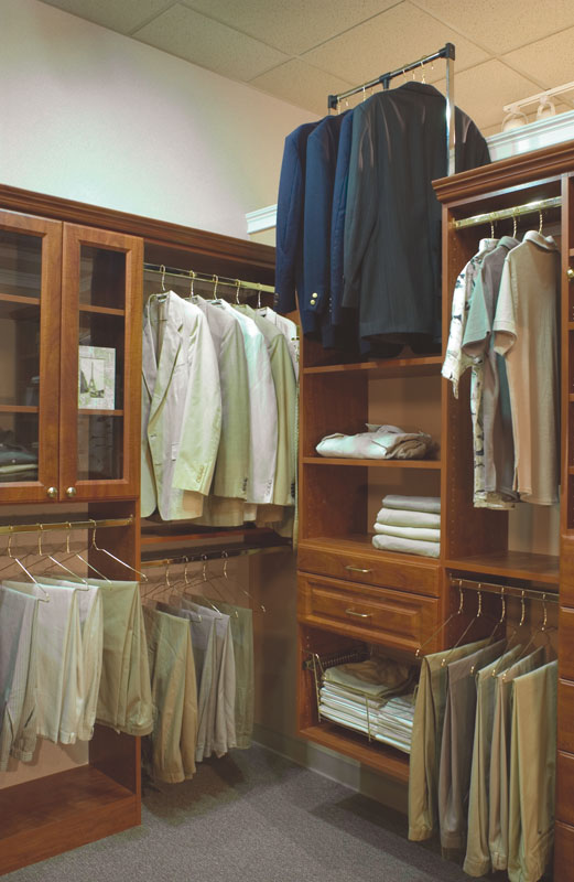 Wardrobe lifts allow for extra hang space in high ceiling closets
