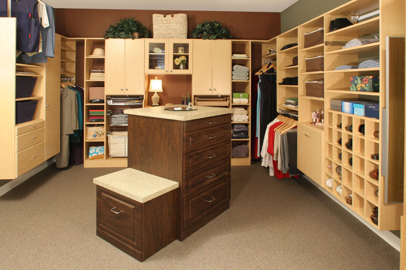 Closet drawers in closets can include islands with seats to increase space in the bedroom