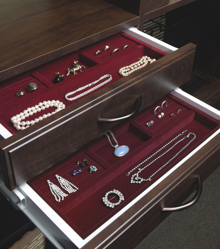 Closet drawers in closets can include jewelty trays